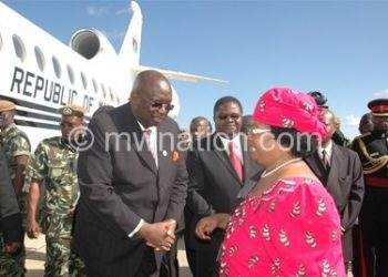 JB bids farewell before boarding the jet, which she later sold