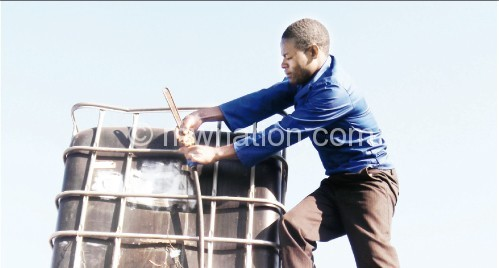 Tabu fixing a tank for one of his customers