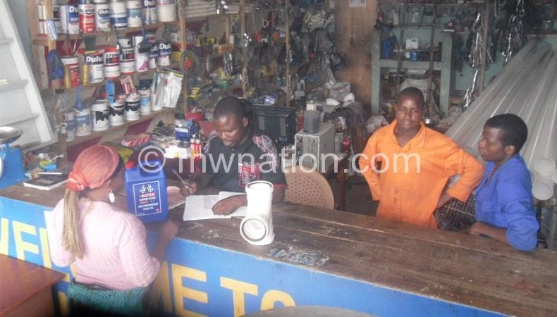 Kholophethe (in black top) attending to a customer