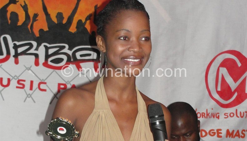 Late Chibale smiles for the camera during one of the events she graced as a mode