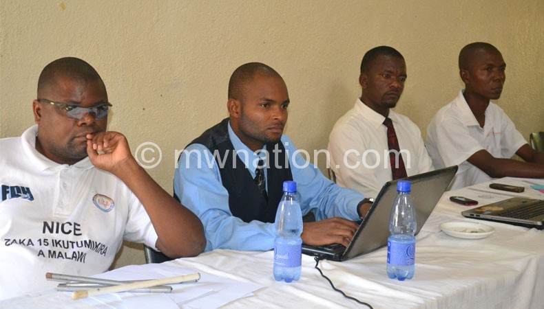 Kumwenda (L) and some officials at the training