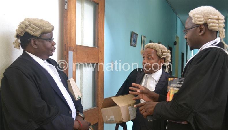 Lawyers Zolomphi Nkowani (L), Chalamanda (C) and Mbeta outside the judge's chamber yesterday