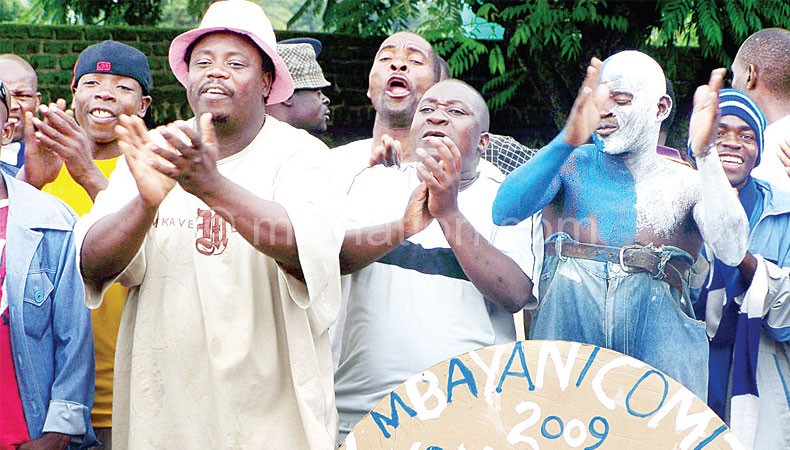 Malunga (2ndL) joins Bangwe zone fans in singing at previous elections