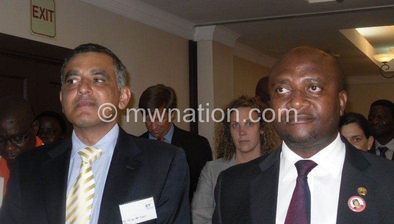 EY country managing partner Shiraz Yusuf (R) with Matola during the launch