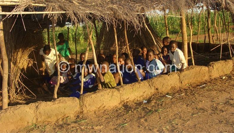 Death trap: Pupils walk out of a makeshift  school block