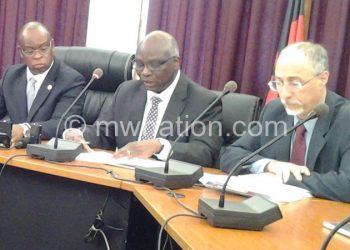 Situation not as gloomy: Tsikata (C) flanked by Mkwezalamba (L) and IMF representative in Malawi Geoffrey Oestreicher