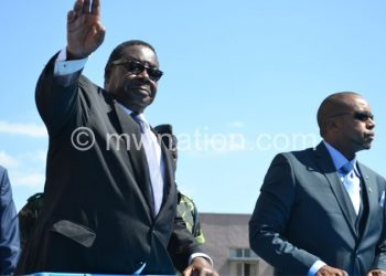 Mutharika (L) won the election on May 20.