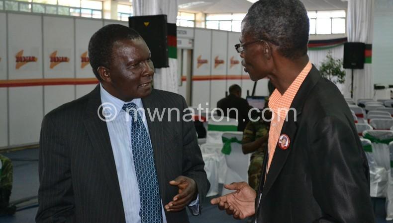 Dausi (L) and PP duputy Ken Msonda at the tally centre on Sunday