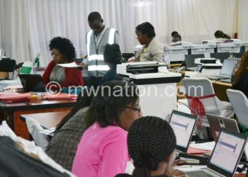 Flashback: MEC staff computing data at the National Tally Centre in Blantyre