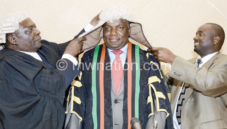 Msowoya being dressed in the Speaker's garb