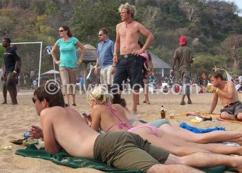 Tourists relax on the beaches of Lake Malawi