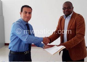 Kasunda (right) presents petition to the egyptian Ambassodor to Malawi Mouhahad El-Ashmawy