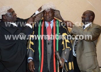 Newly elected Speaker of the National Assembly Richard Msowoya being crowned with the gown of his office after being elected in Lilongwe on Monday