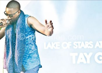 Tay grin performing lake of stars | The Nation Online