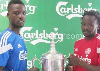 Kondowe (R) and Wanderers' Kaipa display uniforms and trophy