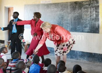 Norwegian Ambassador to Malawi Eidhammer Asbjorn,Education Minister Dr Fabiano and UN resident coordinator Mia Seppo signs the agreement at Nthuli Primary School in Dedza on Wednesday