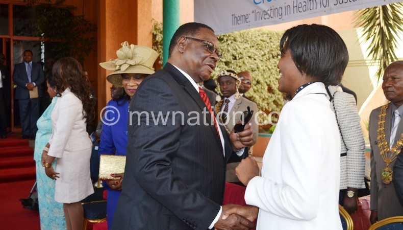 Mutharika with Chairperson for the Parliamentary Committee on Health Julliana Lunguzi