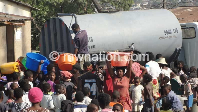 Blantyre residents being served by a water bowser after their taps run dry for days on end