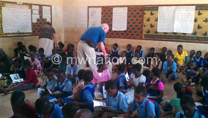 Pupils in class reading | The Nation Online