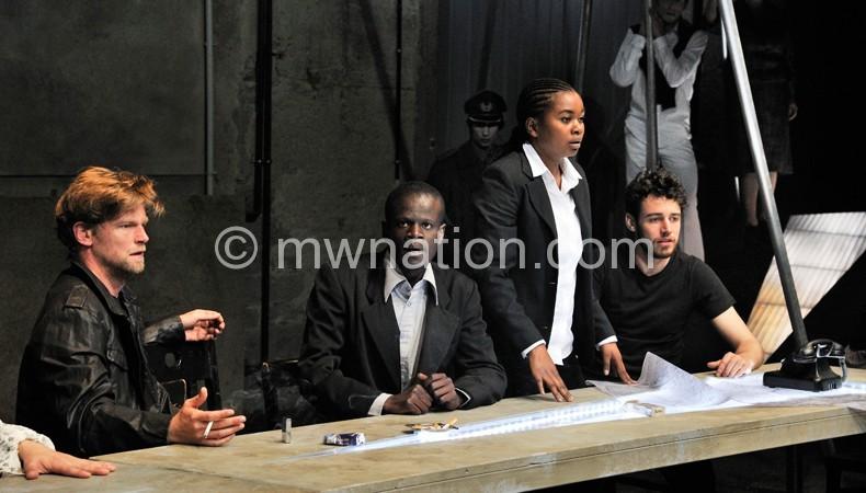 Mjumira (2nd L) and Otooli Masanza (2nd R) starring in Germany production