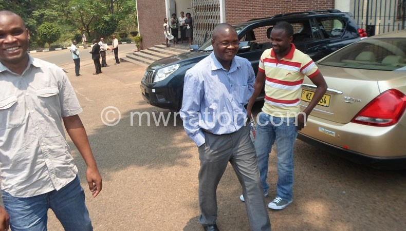 Lutepo (C) outside the High Court building in Zomba yesterday
