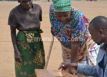 An elderly woman votes during the May elections