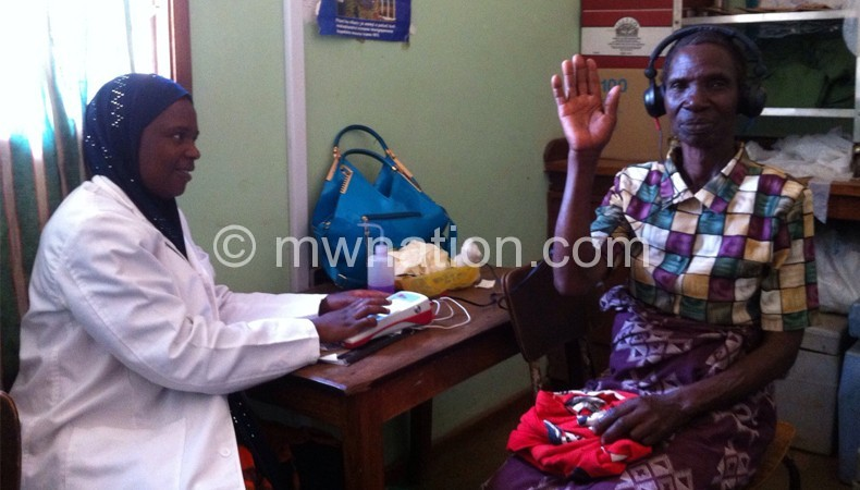 Mwanaisha conducting hearing assessment tests
