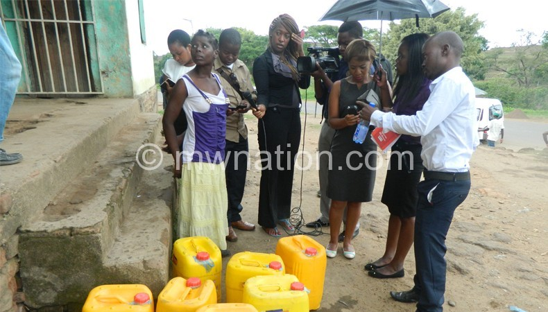 Mawindo (L) briefing journalists on the problems faced to draw water