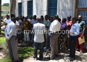 Blantyre ACB staff getting an update after their offices were sealed on Tuesday