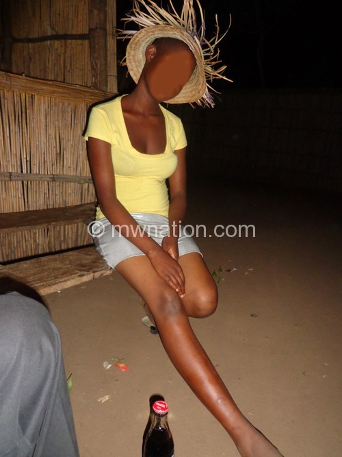 A teenage ekes a living as a sex worker at on of the shebeens in Salima