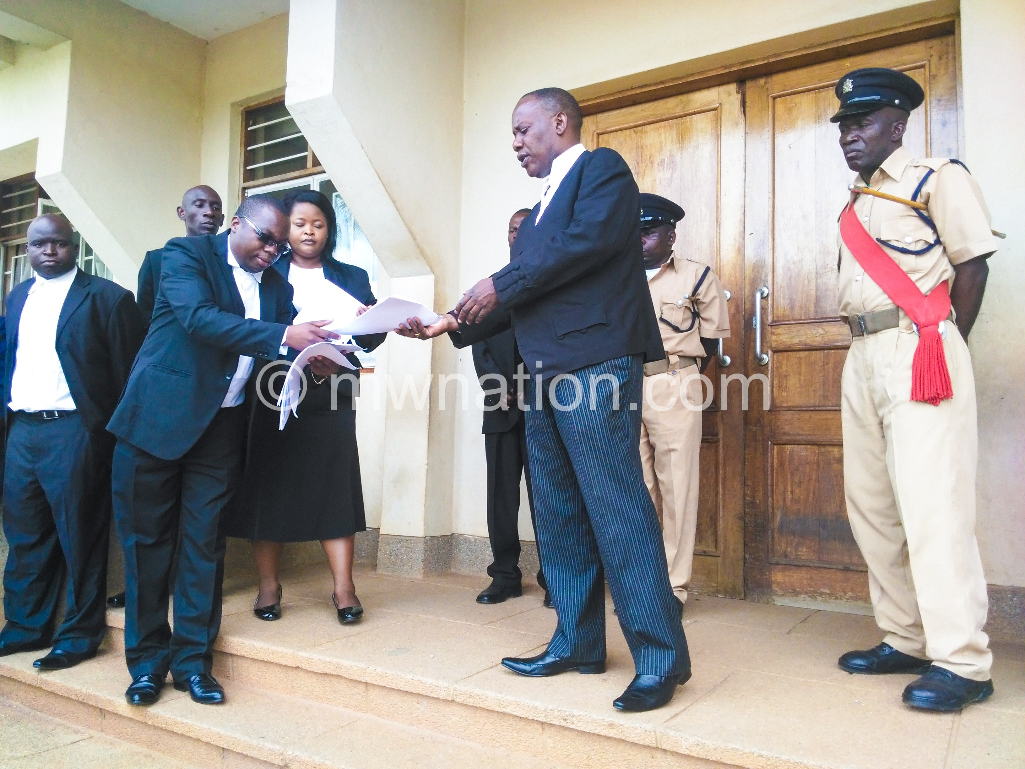 Gondwe (in glasses) presenting the petition to Madise on Monday