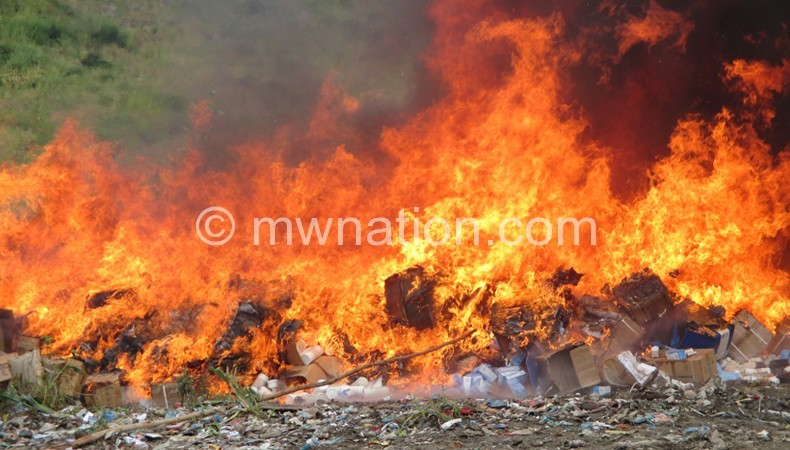 Up in flames: The expired drugs and medical supplies during the destruction in Blantyre yesterday