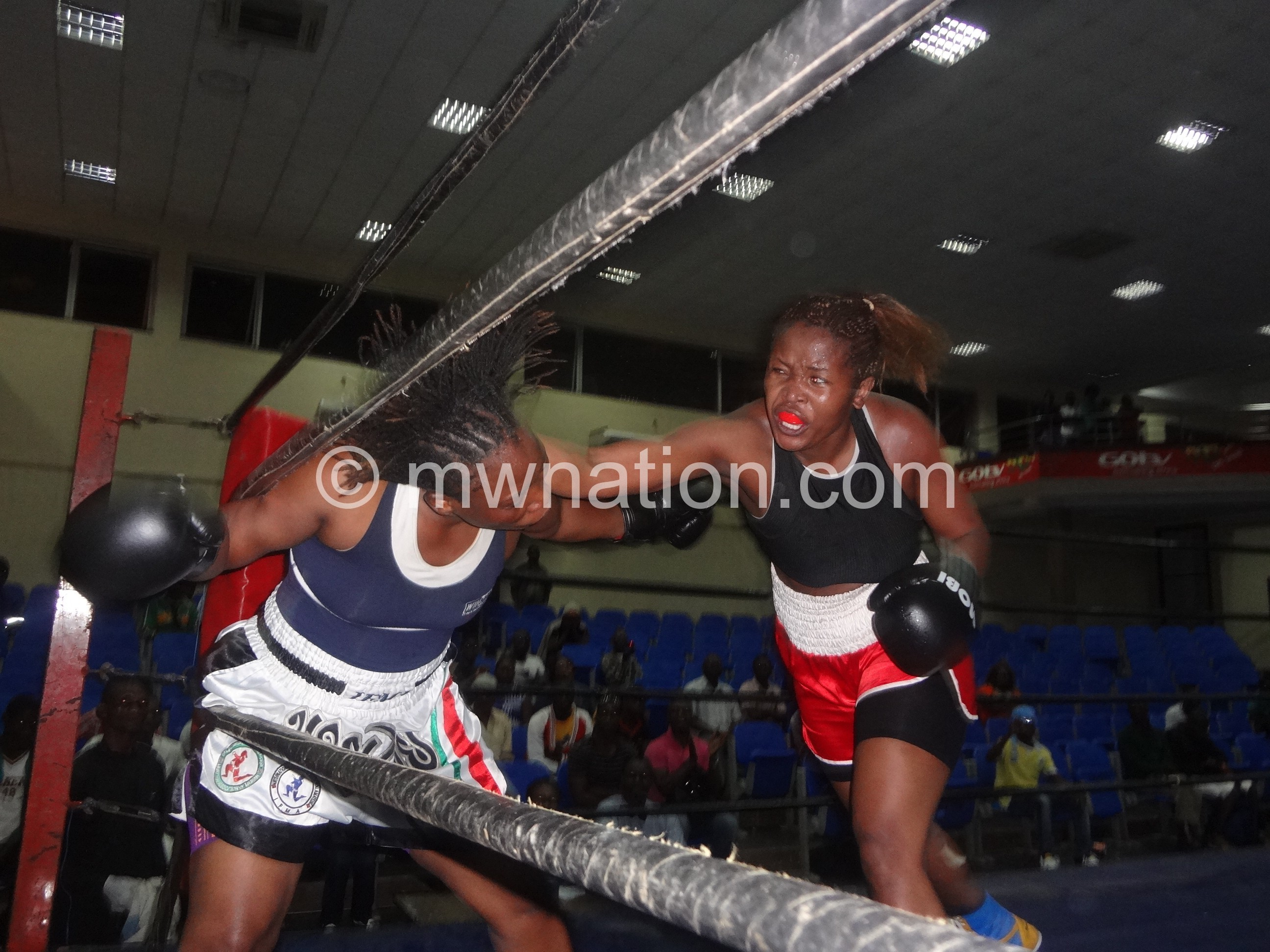 Mtimaukanena (R) lands a punch on Mhubira in the previous fight