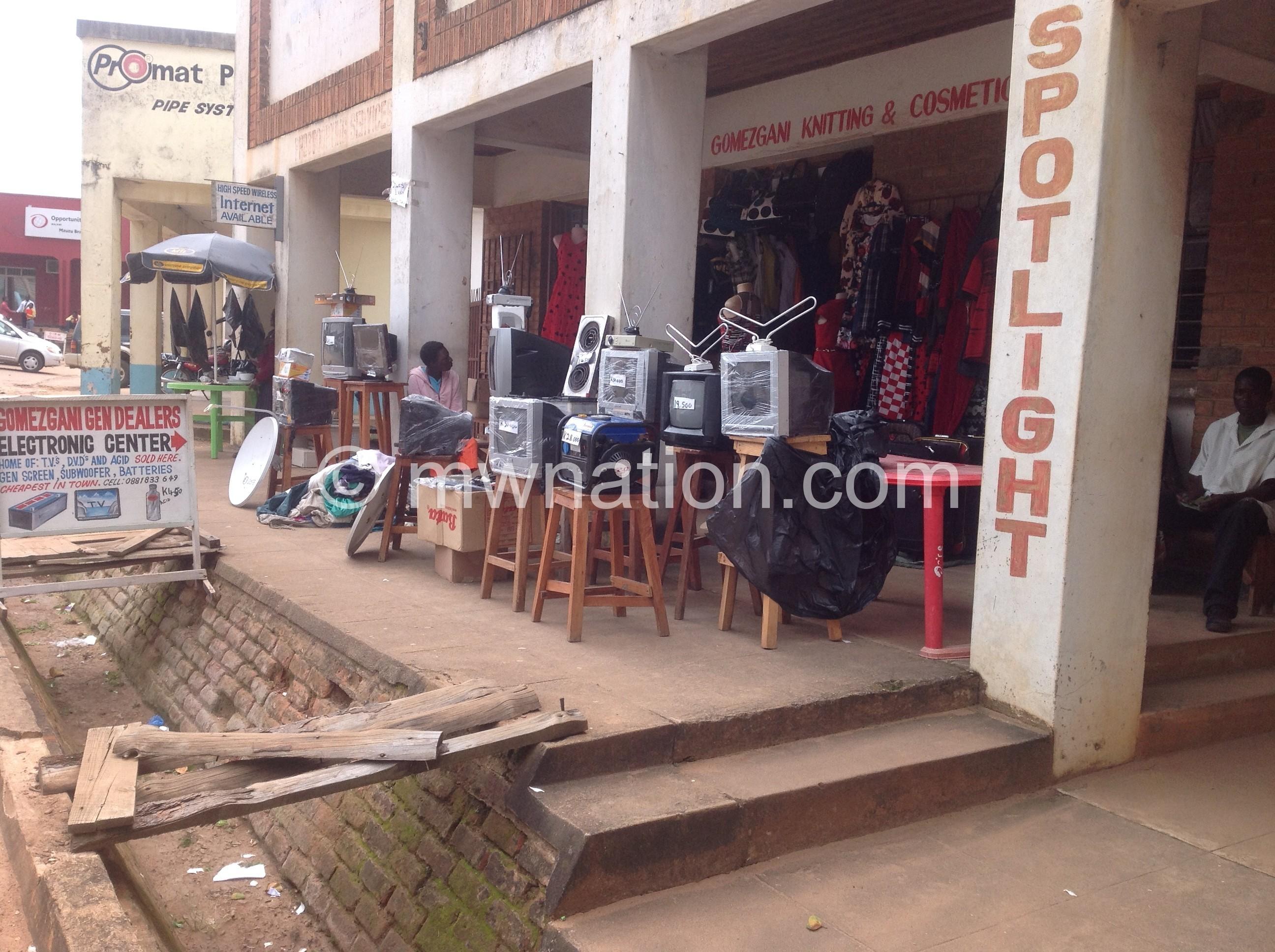Nyirenda displays analogue antennae outside his shop in Mzuzu