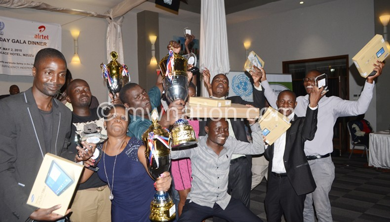Winning team: NPL journalists celebrate the Media House of the Year accolade