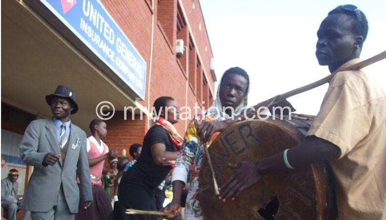 Chirwa (L) leading shalaundi boma during a festival in Mzuzulast week
