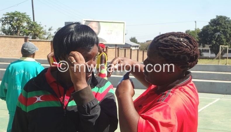 Queens coaches Chawinga-Kalua (L) and Waya discuss during training on Monday