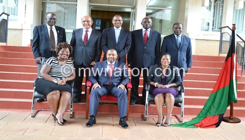 The public service team lead by Chilima (seated C)