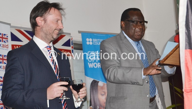 Nevin smiles as Goodall speak to the invited guest