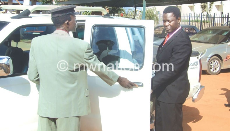 Not so mayoral: Mkandawire (R) boarding his improvised official vehicle, a Nissan Hardbody double cabin pick-up
