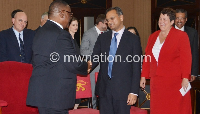 Mutharika bids farewell to Khan as US Ambassador Virginia Palmer (R) looks on