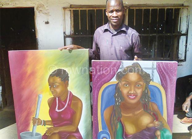 Matembelela showing off some of his artworks