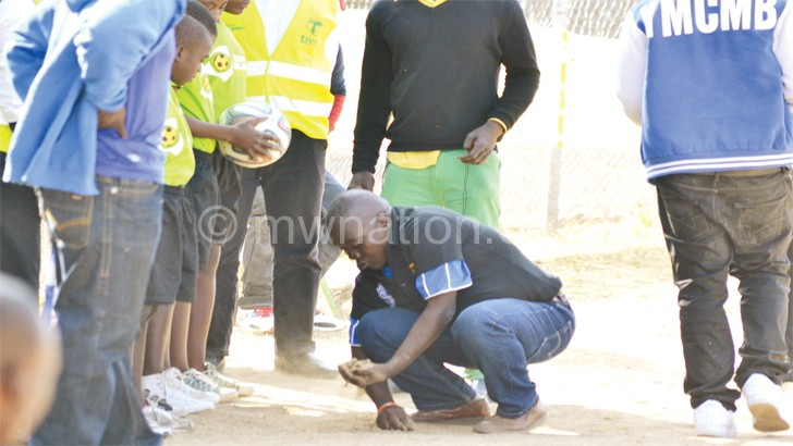 A nomads fan captured removing top soil near the dressing room on suspicion that it contained charms to cast a spell on his team during their league game against Bullets