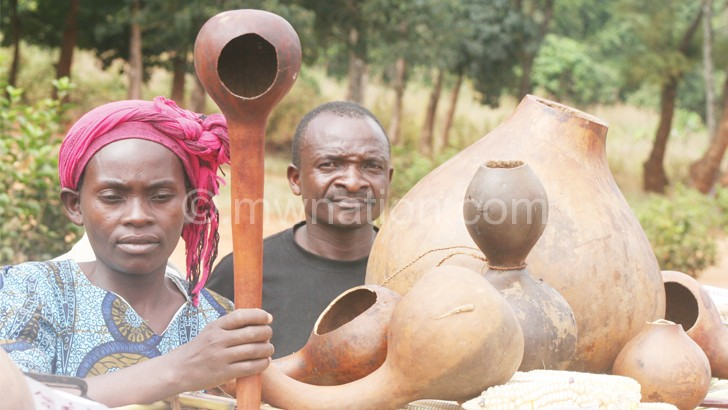Residents show off the different calabashes during the fair