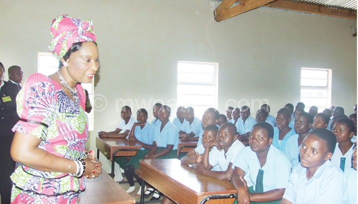 The First Lady interacting with pupils at Baula CDSS where she handed over two school blocks and a teacher's house