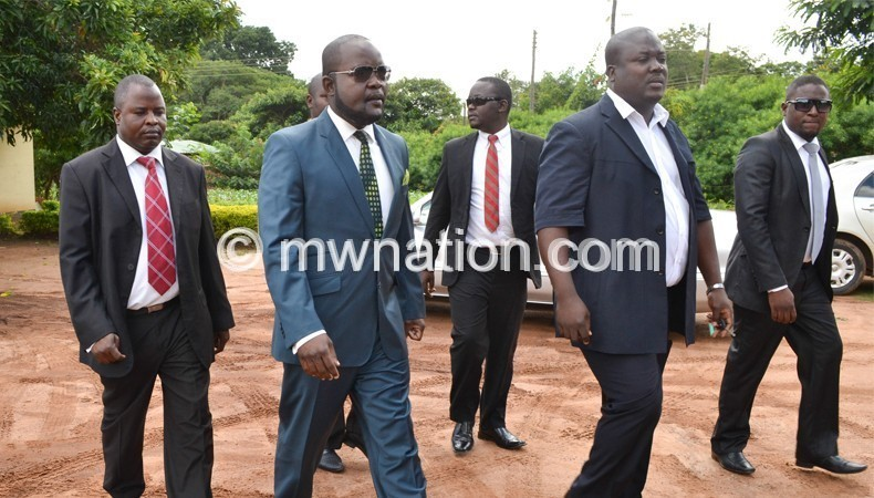 Mphwiyo (2nd from L) with sympathisers during an  earlier court appearance