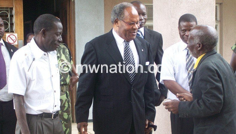 Muluzi sharing a lighter moment with sympathisers after an earlier  court adjournment