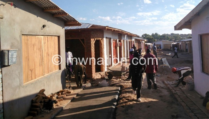 Fresh start: Workers engaged by market traders making final touches to the reconstructed Mzimba Market
