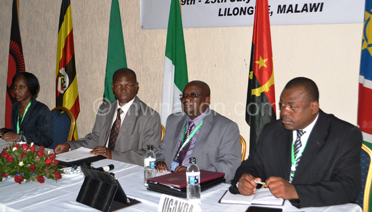 From L-R: Wandika Phiri, Chisamile, Nkhoma and Uganda acting commissioner of prisons Moses Kakungulu during meeting