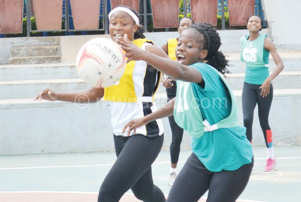 Queens captain Caroline Mtukule-Ngwira (L) moves in to challenge Sindi Simtowe during Tuesday's training session